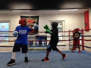 Young boxers in the ring at Elephant in the Room Boxing Club in New Haven